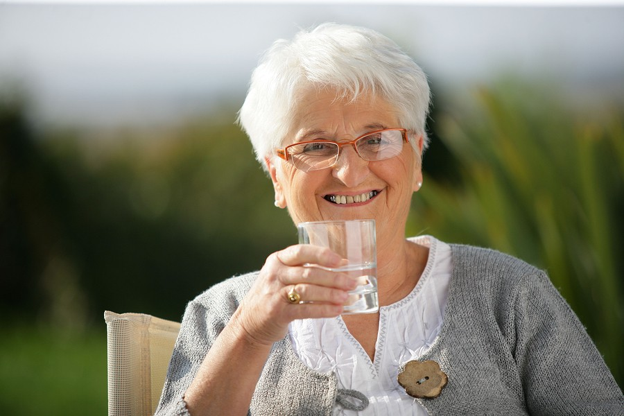 Home Care Senior woman with a glass of water