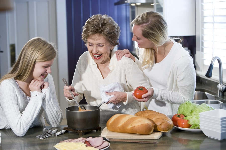 Grandmother With Family Cooking In Kitchen in Virginia