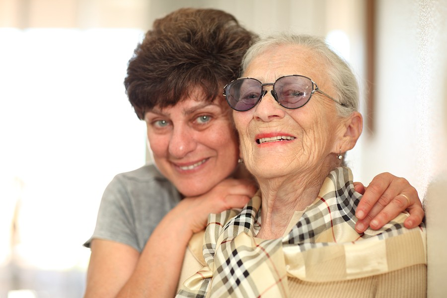 bigstock-Happy-Woman-With-Elderly-Mothe-12555725